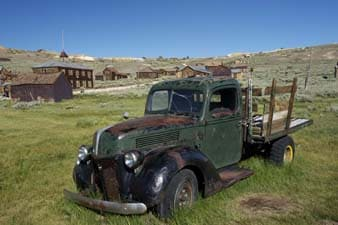 old truck parked near ghost town